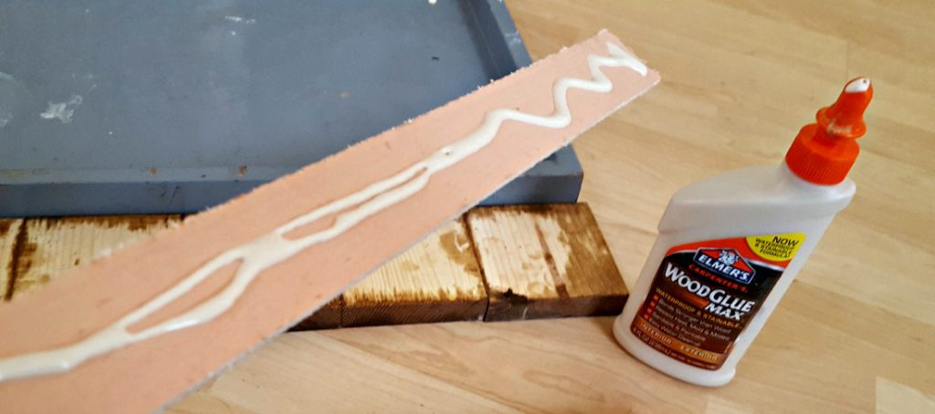 gluing wood to wall art