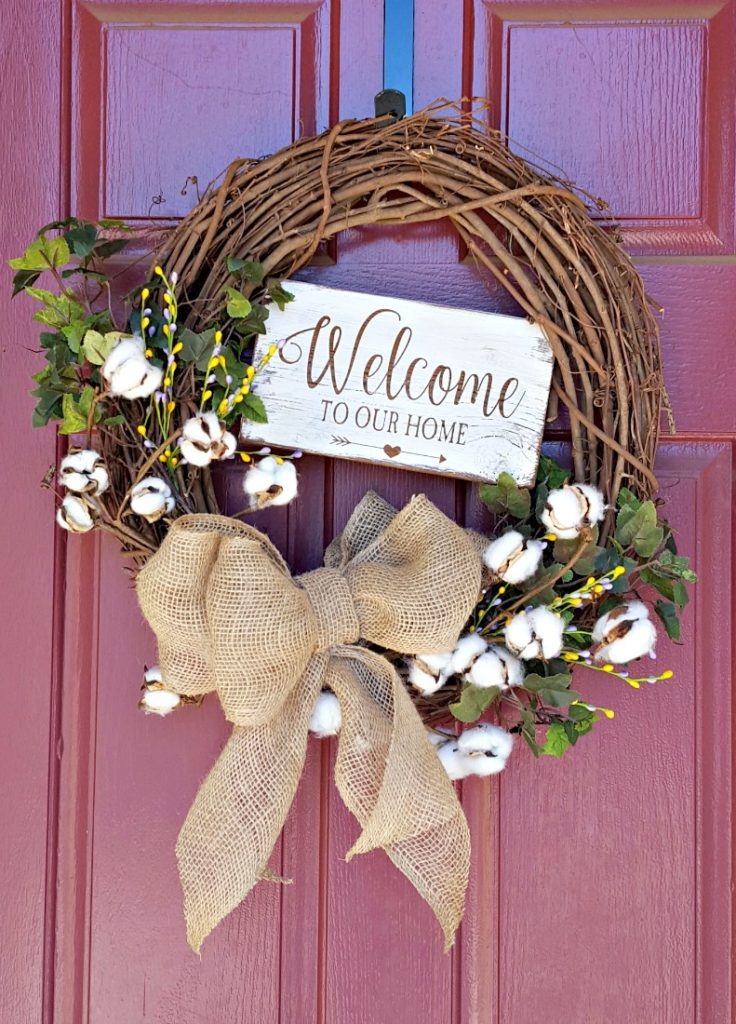 DIY grapevine spring wreath tutorial with welcome to our home sign