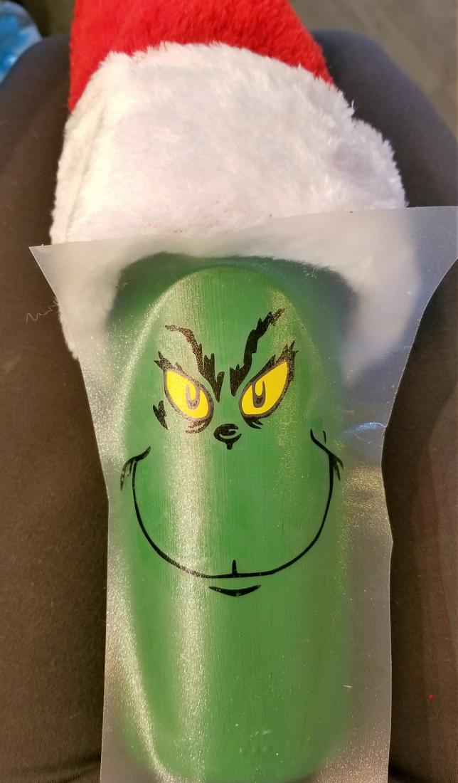 grinch decorated wine bottle