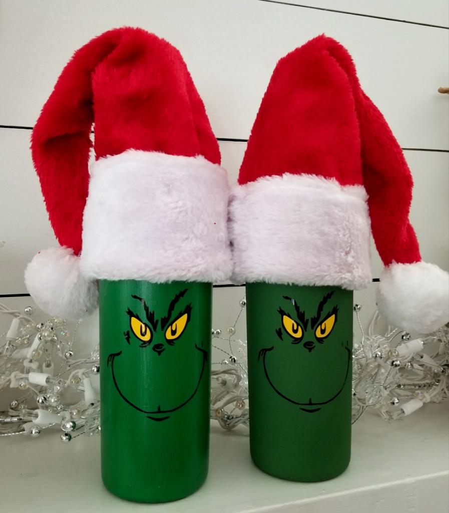 diy grinch Christmas wine bottles with Santa hats