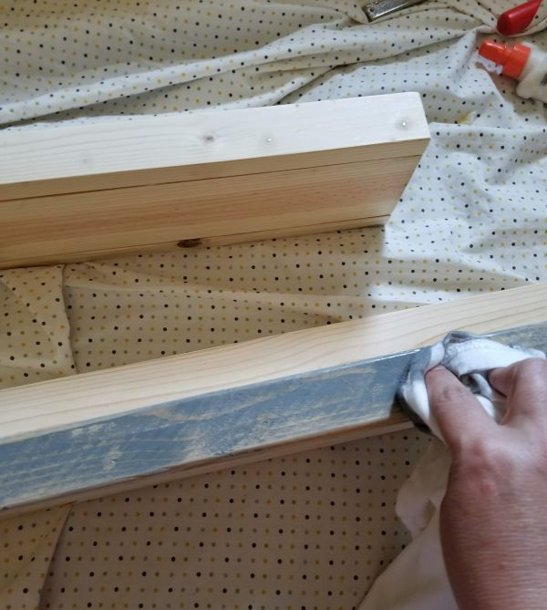 staining homemade rustic shelves