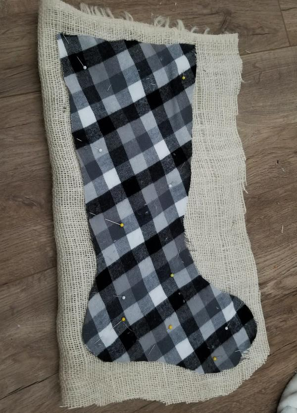 pinning buffalo plaid stockings with burlap