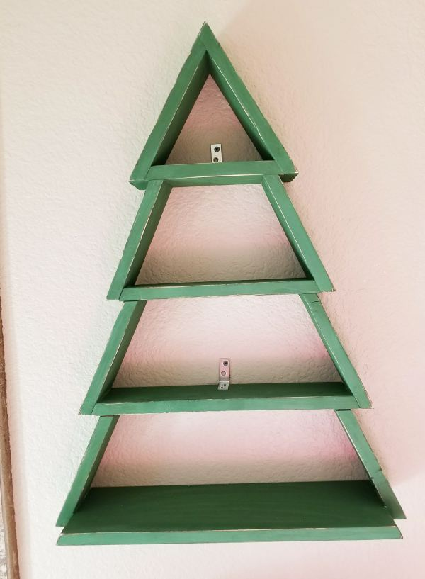 wooden christmas tree hung on wall